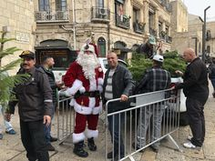 Red-suited ex-basketball player Issa Kassissieh, a Christmas fixture in the Old City, is cheerier than ever this year after training at Denver's Professional Santa Claus School