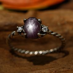 Star ruby ring with diamonds side set gems in prongs setting with sterling silver twist band Check more at