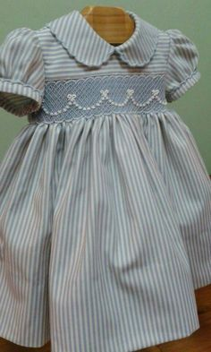 A rope tied with bows on smocking Smocked Baby Clothes, Girls Smocked Dresses, Smocking Baby, Smocking Patterns, Little Girl Outfits, Kids Outfits, Baby Dress Design, Smocks, Heirloom Sewing