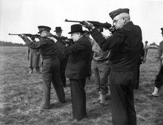 Dwight Eisenhower, Winston Churchill, and Omar Bradley firing new M1 carbines in England (1944)