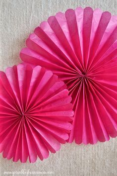 Tissue paper rosettes - Decorate your party space with cute, easy and cheap to make tissue paper rosettes. You can make them in any size or color to match with the rest of your decor. #diy #home #rosettes  www.sprinkleofcinnamon.com