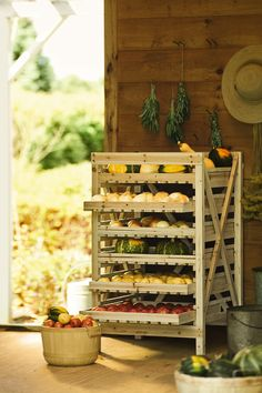 """The Orchard Rack. """"Years ago people stored 'keeper' crops such as apples, winter squash, onions and potatoes on rustic wooden racks just like these. The drawers are slatted to ensure good air circulation and they slide out for easy access. For best results, the rack should be located in a cool, dark cellar or cold room. Perfect for drying herbs too."""""""