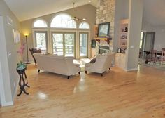 Home features an open design with main level maple wood floors throughout, a vaulted great room with a wall of windows to take in the views of the surrounding forest and golf course, built-in book shelves surrounding the custom fireplace.  905 Silver Fox Drive, Innsbrook, MO 63390 http://www.innsbrook-properties.com/property/mo/innsbrook/63390/innsbrook/905-silver-fox-drive/53695110960df91d0c000322/