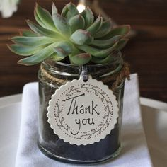 We do could these as the place card holders/gifts. I love the idea of giving a succulent