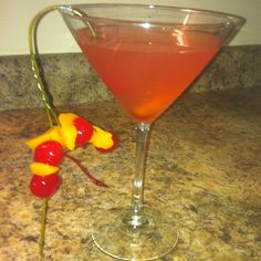 """The """"Christini"""" by Bud ~ in honor of """"Mommy Dearest"""" ~ wire hanger NOT optional.  ]=0  2 parts vodka 1 part Orangina 1 part Blood Orange soda 1 part Pink Lemonade Dash of cherry juice Dash of bitters Garnish with fruit on wire hanger"""