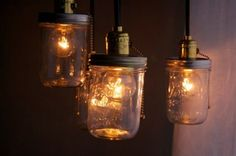 Kerr jars make a great pendant cover and are attached to a remote dimmer