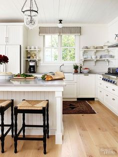 Modern farmhouse kitchens are breezy, easy, and cheerfully bright. This chic kitchen includes country influences presented in an up-to-the-minute manner. Wood-clad ceilings, plank floors, beaded-board cabinets, and open shelves near the sink provide informal forms, while a bell jar pendant light and a snazzy tiled backsplash present more refined figures and textures./