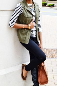 J.Crew green utility vest, striped shirt, black pants, statement necklace - Spark & Cemistry Blog (great key pieces- stripes, neutrals and patterns)