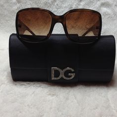 Dolce & Gabbana Sunglasses Tortoise frames with DG gold & rhinestone logo on arms at temples, brown lenses, made in Italy. Arms are tight. Original carrying case. Very light scratch on left lens and small chip on top of frame on right. Dolce & Gabbana Accessories Sunglasses