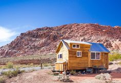 This is a custom tiny house on wheels designed and built by Old Hippie Woodworking & Design in Las Vegas, Nevada. From the outside, you'll notice it features a side-entrance, mini storage…