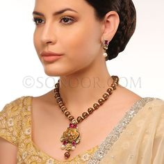 PEN/1/3433 Pinal Pendant Set with Earrings in dull gold finish studded with kundan, jade and meena kari 	 $288	 £170