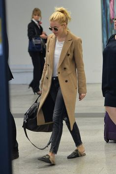 Celebrity airport style: jeans camel colored cost white tee and Gucci loafers fashion casual