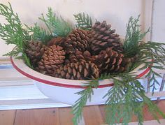 Greenery and pinecones in an enamelware bowl (from Ticking and Toile)