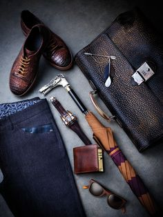 Some fine men's accessoires.hella diggin the leather pattern on the shoes, the badass thunderbolt watch, and the swaggy wood sungalss. not sure what the arrow is, but i like it
