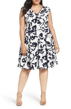 Free shipping and returns on London Times Lace Inset Floral Fit & Flare Dress (Plus Size) at Nordstrom.com. Lace gussets in the pleated skirt add a touch of romantic charm—and extra flare—to a spring dress in a graphic floral print with striking black-and-white sophistication. Another hint of lace trims the V-neckline.