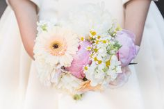 pastel hued bouquet with peonies, gerbera daisies, dahlias and chamomile