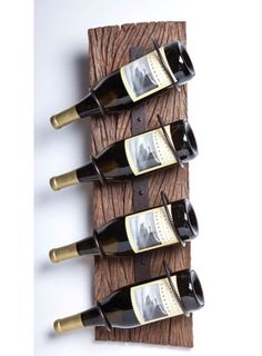 "4 Bottle Wood & Metal Wall Wine Rack for $79.00 from WineRacks.com    Dimensions: 24"" h x 8"" w x 6"" d  Capacity: 4 bottles    A rustic slab of wood supports metal wine brackets.  Image shows the rack used horizontally, but it works just as well in a vertical orientation."