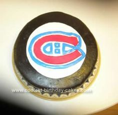 Homemade Habs Hockey Puck Cake: For this Habs Hockey Puck Cake, I used my regular chocolate cake recipe (from Baker's Chocolate) and baked two 8 round cakes. Between my layers, instead