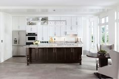 Gorgeous mix and match kitchen, white cabinets with the deep dark island with our Aristokraft cabinet line.