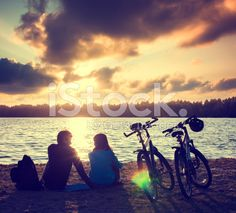 Couple with Bicycles Relaxing at Sunset royalty-free stock photo