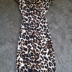 Dress NWOT leopard print dress from Charlotte Russe, has small opening in the back. Size xs. Charlotte Russe Dresses