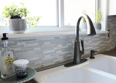 LOVE smudge-resistant pasadena faucet in slate for a grey and white kitchen, House For Five featured on Remodelaholic