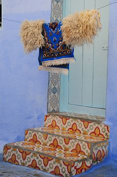 """Chefchaouen, the beautiful """"blue"""" city in the north of Morocco. The tile steps are eye-catching. Moroccan Design, Moroccan Style, Moroccan Rugs, Riads In Marrakech, Tangier Morocco, Tile Steps, Cement Steps, Chefchaouen, Cultural Architecture"""