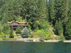 House and extra building lot to the North. Lake CdA just North of Black Rock Bay, house with extra building lot, large shop above house, spa in master, view of lake from every room, shared 360' of waterfront, common dock with 2 boat slips, large view deck, paved driveway, cart path to Black Rock and Rock Creek Golf Clubs (some restrictions). Membership in waterfront cabana and 20 acres, sprinkled landscape, all appliances, well water, basketball court, garage. Second lot is buildable.