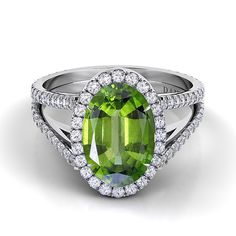 Brides.com: . Style CE111-OV, Danhov couture collection with peridot center stone, $3,980, Danhov  See more oval-cut engagement rings.