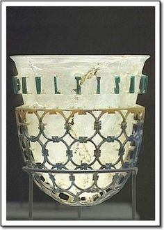 Roman cage vase, 4th century A.D. There is a dispute among scholars as to how these vessels were created. One theory describes a Roman glass technique called diatretum, where thick walled blanks were cut back to create the complex design. Another suggests the cups were cut from a two shelled plaster and quartz powder mold. Since plaster does not stick to glass and becomes brittle after contact with hot glass it could then be easily removed.