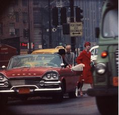 NYC. Anne St-Marie + Cruiser in Traffic, New York (Vogue), 1962 // William KLEIN