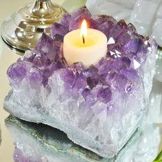 "Amethyst Cluster Candle Holder. Handcrafted with extreme precision this Amethyst Cluster Candle Holder is a piece of art. Purple Amethyst has been highly esteemed throughout the ages for its stunning beauty and legendary powers to stimulate, and soothe, the mind and emotions. It is a semi-precious stone in today's classifications, but to the ancients it was a ""Gem of Fire,"" a Precious Stone worth, at times in history, as much as a Diamond. I"