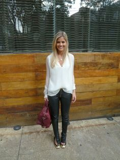 Super cute look. Leather pants with white blouse tucked just in front.