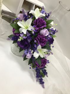Deep purple roses Lavenders White lilies Lavender roses with greenery Teardrop Purple Wedding Bouquets, Floral Bouquets, Wedding Colors, Wedding Flowers, Floral Wreath, Wedding Stuff, Lavender Roses, Purple Roses, Purple Wedding Stationery