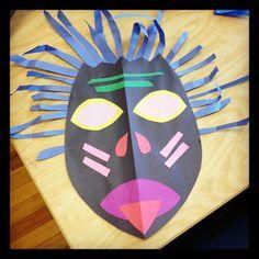 Cut paper African masks for November Kenya - good for symmetry