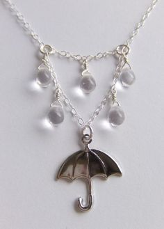 Rain - Rainy Day With My Umbrella necklace in Sterling Silver by LycheeKiss from http://www.etsy.com/listing/60854244/rainy-day-with-my-umbrella-silver