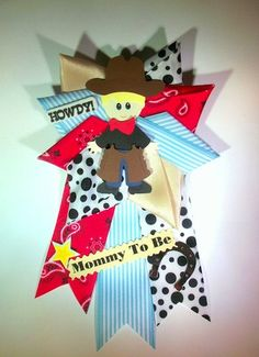 Cute Cowboy Baby Shower Corsage for the western theme baby shower.  Mommy to be will love wearing this to her cowboy themed baby shower party.