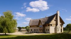 Traditional House With Thatched Roof And Curved Wall, Hampshire Thatched House, Thatched Roof, Bulthaup Kitchen, New Forest, Elegant Homes, Plan Design, Architect Design, Traditional House, Modern Architecture