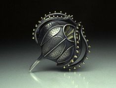 Plankton Art - Silver and Gold by Sarah Parker-Eaton. metal forming, texturing, soldering, and other techniques.