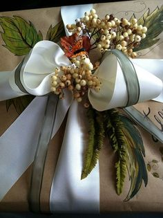 Gift wrapping idea - Dress up boxes wrapped in brown paper with luxurious wide satin ribbon you buy on sale and flowers. #giftwrapping #brownpaper #kraft
