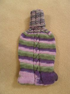 Knit hot water bottle cover.  Buttons on the lower back to make it easy to get the hot water bottle in and out.