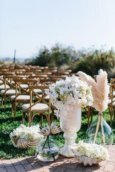Aisle Decor | Design & Production: Kristin Banta Events; Photography: Breadon Photography #wedding #beachwedding #southbay #losangeles #ceremony #kristinbanta #insidewedding #floralarrangements #aisledecor