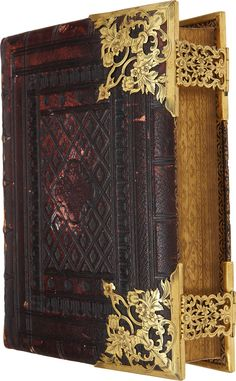 The Holy Bible: Containing the Old and New Testaments. London: Samuel Bagster and Sons, [n.d., ca. 1855]. Quarto. 1338 pages. Publisher's full morocco with decorative brass corners and clasps. Blind-stamped with gilt spine title. All edges gilt and gauffered. Marbled endpapers