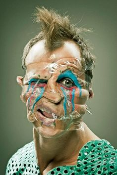 Photographer Wes Naman has discovered that scotch tape is a pretty hilarious accessory for taking portraits. [via thaeger] You may also like: Extremely Clever Pregnancy Photo Series Pics) Switcheroo: Couples Swapping Outfits Photoshop, Wes Naman, Zine, Tape Face, Ugly To Pretty, Scotch Tape, We Are The World, Pictures Of People, Plastic Surgery
