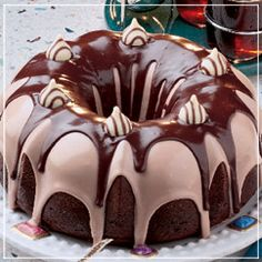 Raspberry Fudge Icing Chocolate Bundt Cake - Ingredients:3 cups sugar,3 cups all-purpose flour,1 14 cups cocoa,1 tsp baking soda,1 tsp baking powder,1 tsp salt,3 eggs,1 cup vegetable oil,1 cup buttermilk,1 cup hot water,1 tbsp vanilla,1 12 lbs milk chocolate (chopped and melted),1 cup heavy whipping cream,1 cup raspberry jam, 1 tsp flavoring (raspberry, optional),1 lb milk chocolate... Recipe was based from…
