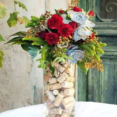 If you're planning a winery theme wedding, explore these simple DIY wedding ideas that highlight cork to make stunning centerpieces and more. Wine Cork Centerpiece, Wine Bottle Centerpieces, Wedding Table Centerpieces, Flower Centerpieces, Bottle Vase, Centerpiece Ideas, Wedding Decorations, Wine Cork Wedding, Wedding Wine Bottles