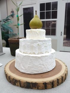 "wheels of cheese as ""wedding cake"" for wine hour - would be good for wedding shower or wedding cocktail hour"