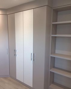 Our Oceana range in white textured front complimented with grey wood grain finish, sparkly diamanté handles and adjustable shelving by M&S Bedrooms Ltd.