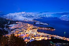 Queenstown Snow Night by Jason Law.     Queenstown Night Life.. It was a bitterly cold evening up the Skyline Gondola tonight.. but getting home and editing this image made it all worthwhile.. The mountains that surround the town are amazing anytime of year, but when it snows to lake level the whole place becomes a fairy tale town..     Add it to your must visit locations.. Ive travelled extensively and Im proud to say my favourite location in the whole world is now my home.. :)…