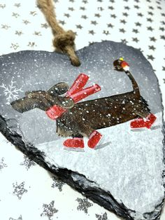 Dachshund Christmas Slate  Beautiful hand painted Christmas decoration, a cute little sausage dog in the snow with his friend Mr Robin. Perfect little decoration for the festive season, also makes a lovely gift for a Dachshund lover.